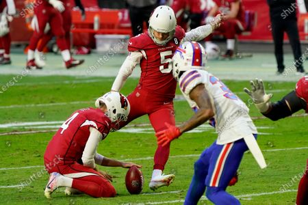 Arizona Cardinals kicker Zane Gonzalez (5) kicks a field goal as punter Andy Lee (4) holds during the first half of an NFL football game against the Buffalo Bills, in Glendale, Ariz