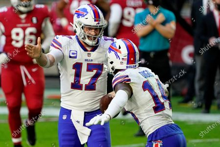 Buffalo Bills quarterback Josh Allen (17) celebrates his touchdown with wide receiver Stefon Diggs (14) during the first half of an NFL football game against the Arizona Cardinals, in Glendale, Ariz