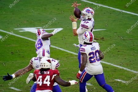 Stock Image of Buffalo Bills quarterback Josh Allen (17) bobbles the football as running back Zack Moss (20) looks on during the first half of an NFL football game against the Arizona Cardinals, in Glendale, Ariz