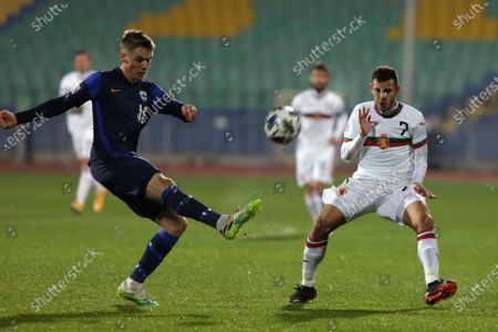 Bulgaria's Dominic Yankov (R) in action with Finland's Robert Taylor (L) during the UEFA Nations League group stage, League B, Group 4 match between Bulgaria and Finland.