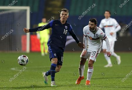 Bulgaria's Galin Ivanov (R) in action with Finland's Robert Taylor (L) during the UEFA Nations League group stage, League B, Group 4 match between Bulgaria and Finland.