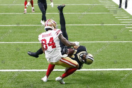 New Orleans Saints cornerback Patrick Robinson intercepts a pass intended for San Francisco 49ers wide receiver Kendrick Bourne (84) in the second half of an NFL football game in New Orleans, . The Saints won 27-13