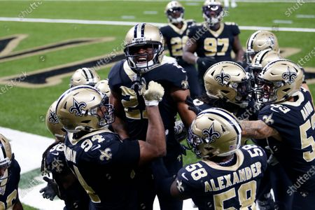 New Orleans Saints players hoist cornerback Patrick Robinson (21) after his late game interception in the end zone in the second half of an NFL football game against the San Francisco 49ers in New Orleans, . The Saints won 27-13