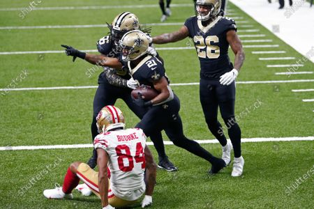 New Orleans Saints cornerback Patrick Robinson (21) celebrates his interception, intended for San Francisco 49ers wide receiver Kendrick Bourne (84), in the end zone in the second half of an NFL football game in New Orleans, . The Saints won 27-13