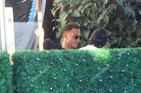 Blake Griffin is seen dining outdoors