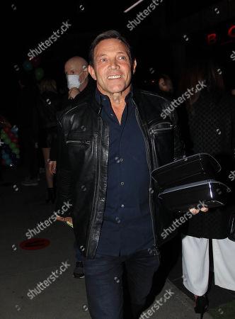 Jordan Belfort is seen carrying leftovers as he leaves BOA Steakhouse