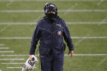 New England Patriots head coach Bill Belichick watches from the sideline while bundled for the rainy weather in the second half of an NFL football game, in Foxborough, Mass