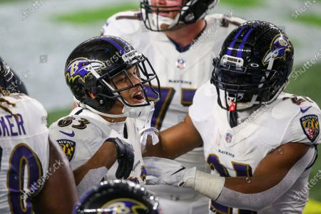 Baltimore Ravens wide receiver Willie Snead IV (83) celebrates with running back Mark Ingram II (21) in front of the End Zone Showtime Cam during the first half of an NFL football game against the New England Patriots, in Foxborough, Mass