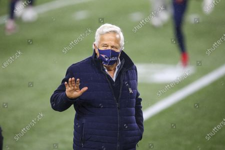 New England Patriots owner Robert Kraft waves prior to an NFL football game against the Baltimore Ravens, in Foxborough, Mass