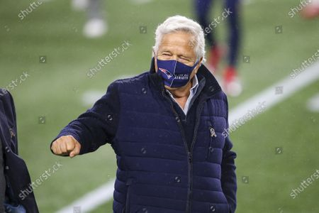 New England Patriots owner Robert Kraft fist bumps an unidentified person prior to an NFL football game against the Baltimore Ravens, in Foxborough, Mass