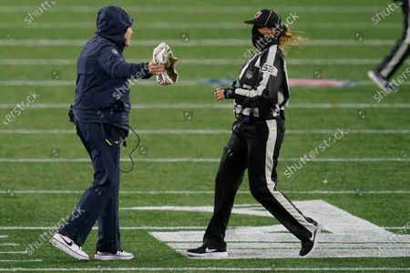 New England Patriots head coach Bill Belichick, left, appeals to down judge Sarah Thomas in the second half of an NFL football game against the Baltimore Ravens, in Foxborough, Mass