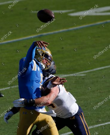 UCLA Bruins quarterback Dorian Thompson-Robinson #1 throws a pass as he gets hit during the NCAA football game between the California Golden Bears and the UCLA Bruins at the Rose Bowl in Pasadena, California. Mandatory Photo Credit : Charles Baus/CSM