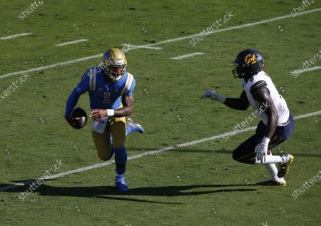 UCLA Bruins quarterback Dorian Thompson-Robinson #1 carries the ball as California Golden Bears linebacker Kuony Deng #8 attempts to make a tackle during the NCAA football game between the California Golden Bears and the UCLA Bruins at the Rose Bowl in Pasadena, California. Mandatory Photo Credit : Charles Baus/CSM