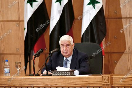 Released by the Syrian official news agency SANA, Syrian Foreign Minister Walid al-Moallem speaks during a news conference in Damascus, Syria. Al-Moallem, a career diplomat who became one of the country's most prominent faces to the outside world during the uprising against Syria's President Bashar Assad, died . He was 79