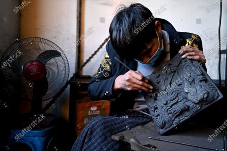 A 23-year-old worker Yang Liang and his colleagues make Sizhou Shiyan by hand in a workshop at the Sizhou Shiyan inheritance Base in Cenggong County of Qiandongnan Miao and Dong Autonomous Prefecture, Southwest China's Guizhou Province, Nov. 14, 2020. Produced in Cenggong County, Qiandongnan Miao and Dong Autonomous Prefecture, Guizhou Province, Sizhou Shiyan has a history of more than 4,000 years. Due to its long history and profound culture, it is deeply favored by the literati and inscribes of all dynasties. It is understood that Sizhou Shi Yan was first handed down in the Tang Dynasty. According to Yang, making a Siczhou stone stone requires more than 30 complicated processes, from quartering, material selection, embryo making to inkstone making. The craftsman will design and carve different shapes and various exquisite patterns and patterns according to the size, texture and shape of each stone. Therefore, each Si Zhou Shi Yan handicraft is a unique boutique.