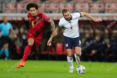 Harry Kane of England (R) dribbles past Axel Witsel of Belgium during the UEFA Nations League group match between Belgium and England in King Power Stadion At Den Dreef, Leuven, Belgium, Nov. 15, 2020.