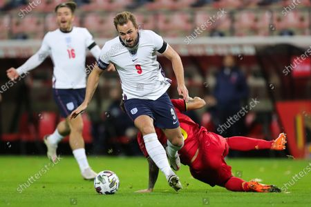 Harry Kane (Front) of England dribbles past Axel Witsel of Belgium during the UEFA Nations League group match between Belgium and England in King Power Stadion At Den Dreef, Leuven, Belgium, Nov. 15, 2020.