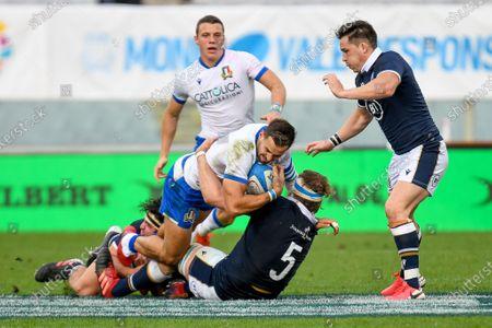 Mattia Bellini (Italy) tackled by Stuart Hogg (Scotland)