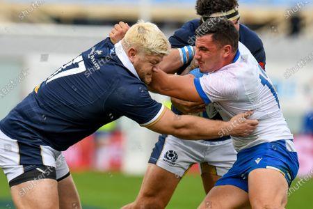 Oli Kebble (Scotland) in action against Marco Zanon (Italy)