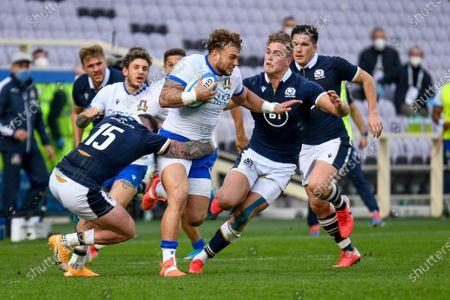 2Giosue Zilocchi (Italy) tackled by Stuart Hogg (Scotland) and Duhan Van der Merwe (Scotland)