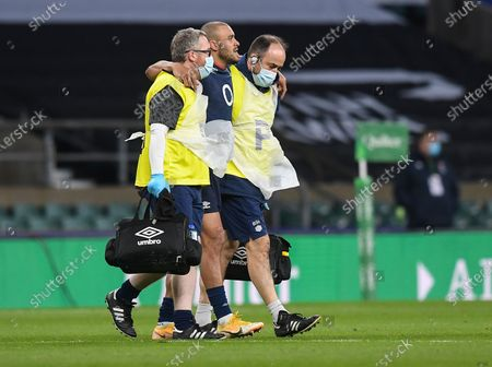 Jonathan Joseph of England leaves the pitch injured