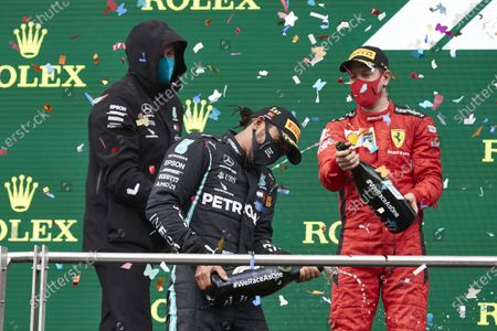 Toto Wolff, Executive Director (Business), Mercedes AMG, Lewis Hamilton, Mercedes-AMG Petronas F1, 1st position, and Sebastian Vettel, Ferrari, , 3rd position, celebrate with champagne on the podium during the 2020 Formula One Turkish Grand Prix