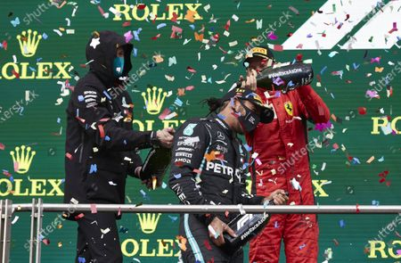 Stock Picture of Toto Wolff, Executive Director (Business), Mercedes AMG, Lewis Hamilton, Mercedes-AMG Petronas F1, 1st position, and Sebastian Vettel, Ferrari, , 3rd position, celebrate with champagne on the podium during the 2020 Formula One Turkish Grand Prix