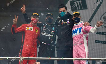 Stock Image of Sebastian Vettel, Ferrari, 3rd position, Lewis Hamilton, Mercedes-AMG Petronas F1, 1st position, Toto Wolff, Executive Director (Business), Mercedes AMG, and Sergio Perez, Racing Point, 2nd position, celebrate on the podium during the 2020 Formula One Turkish Grand Prix