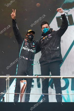 Lewis Hamilton, Mercedes-AMG Petronas F1, 1st position, and Toto Wolff, Executive Director (Business), Mercedes AMG, celebrate on the podium during the 2020 Formula One Turkish Grand Prix