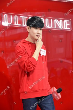 Stock Photo of JJ Lin promotes for Shiseido red power station store by wearing a red fleece in Taipei,Taiwan,China on 14 November 2020