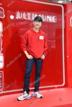 Stock Image of JJ Lin promotes for Shiseido red power station store by wearing a red fleece in Taipei,Taiwan,China on 14 November 2020