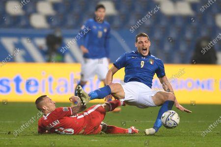 "Stock Image of Andrea Belotti (Italy) Jacek Goralski (Poland)                            during the UEFA ""Nations League 2020-2021"" match between Italy 2-0 Poland   at Mapei Stadium  on November 15 , 2020 in Reggio Emilia, Italy."