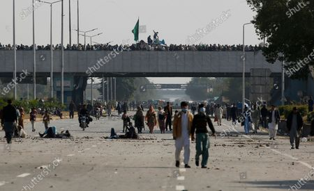 Supporters of Tehreek-e-Labaik Pakistan, a religious political party, block a main highway during an anti-France rally in Islamabad, Pakistan, . The supporters are protesting the French President Emmanuel Macron over his recent statements and the republishing in France of caricatures of the Muslim Prophet Muhammad they deem blasphemous