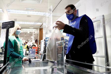 Former Spanish National Soccer Team goalkeeper Iker Casillas (R) buys food as he co-operates as a volunteer in the 8th Great Food Collection Campaign for underprivileged at a hypermarket in the town of Pozuelo de Alarcon, Madrid, Spain, 16 November 2020. The event is organized by Spanish Food Banks Federation.
