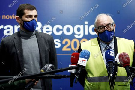 Former Spanish National Soccer Team goalkeeper Iker Casillas (L) and Pablo Prada Hernandez, Madrid Food Bank's Deputy President, talk to media as they co-operate as a volunteer in the 8th Great Food Collection Campaign for underprivileged at a hypermarket in the town of Pozuelo de Alarcon, Madrid, Spain, 16 November 2020. The event is organized by Spanish Food Banks Federation.