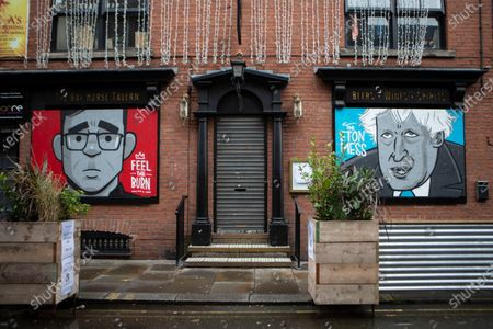 A business in Northern Quarter displays likeness of Andy Burnham and Boris Johnson.