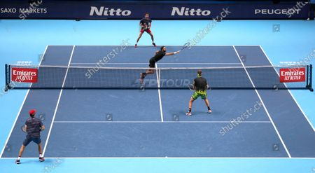 Marcel Granollers of Spain and Horacio Zeballos of Argentina play a return to John Peers of Australia and Michael Venus of New Zealand during their doubles match at the ATP World Finals tennis match at the O2 arena in London
