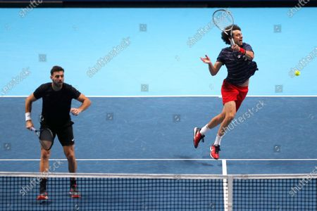 Marcel Granollers of Spain, left, and Horacio Zeballos of Argentina play a return during their doubles match against John Peers of Australia and Michael Venus of New Zealand at the ATP World Finals tennis match at the O2 arena in London