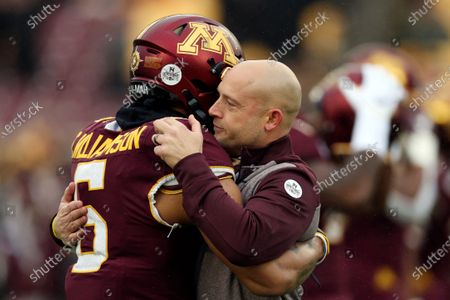 Minnesota head coach P.J. Fleck hugs defensive back Chris Williamson (6) during an NCAA college football game against Wisconsin, in Minneapolis. Fleck has never lacked for clever ways to connect and motivate his players