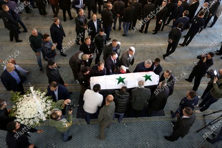 Syrian mourners carry the coffin of Deputy Prime Minister, Minister of Foreign Affairs and Expatriates Walid al-Moallem, in Damascus, Syria, 16 November 2020. Walid al-Moallem died aged 79 on 16 November 2020. He will be buried in the Mezzeh cemetery after funeral prayer at the Saad bin Muadh mosque.