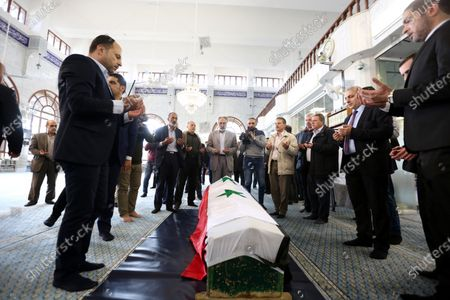Syrian mourners perform the funeral prayers next to the coffin of Deputy Prime Minister, Minister of Foreign Affairs and Expatriates Walid al-Moallem, in Damascus, Syria, 16 November 2020. Walid al-Moallem died aged 79 on 16 November 2020. He will be buried in the Mezzeh cemetery after funeral prayer at the Saad bin Muadh mosque.