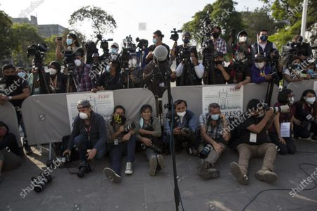 Reporters wait for Peru's new interim President Francisco Sagasti after he was designated by Congress to lead the nation, in Lima, Peru, . Lawmakers chose Sagasti to become the nation's third president in the span of a week after they ousted Martin Vizcarra and the following protests forced his successor Manuel Merino to resign