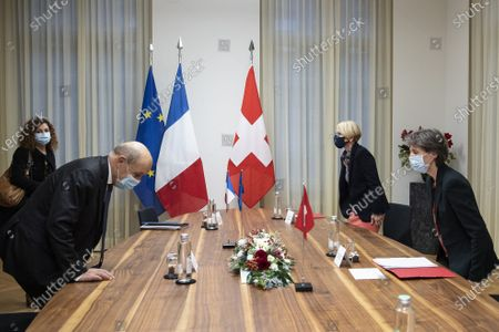 Swiss Federal President Simonetta Sommaruga (R) welcomes Jean-Yves Le Drian (L), Foreign Minister of France, during an official visit to Switzerland, in Bern, Switzerland, 16 November 2020.