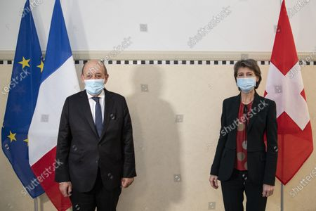 Stock Photo of Swiss Federal President Simonetta Sommaruga (R) welcomes Jean-Yves Le Drian (L), Foreign Minister of France, during an official visit to Switzerland, in Bern, Switzerland, 16 November 2020.