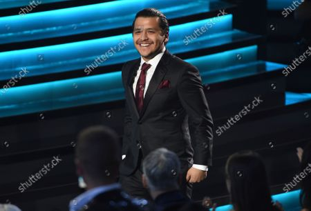 """Christian Nodal accepts the award for best ranchero/mariachi album for """"Ahora"""" at the 20th Latin Grammy Awards in Las Vegas on . Nodal launched his single with Angela Aguilar, """"Dime cómo quieres,"""" on Nov. 13, 2020"""