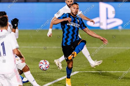 Danilo D'Ambrosio of Internazionale (R) in action during the UEFA Champions League group stage match between Real Madrid and Internazionale at Estadio Alfredo Di Stefano in Madrid, Spain.