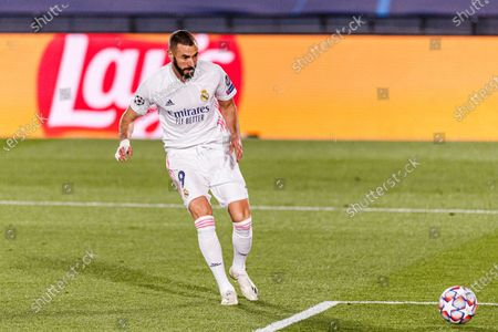 Karim Benzema of Real Madrid attempts a kick for score his goal during the UEFA Champions League group stage match between Real Madrid and Internazionale at Estadio Alfredo Di Stefano in Madrid, Spain.