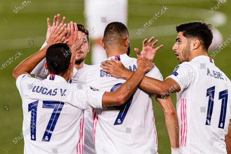 Karim Benzema of Real Madrid (C) celebrates his goal with his teammates during the UEFA Champions League group stage match between Real Madrid and Internazionale at Estadio Alfredo Di Stefano in Madrid, Spain.