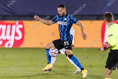 Danilo D'Ambrosio of Internazionale runs with the ball during the UEFA Champions League group stage match between Real Madrid and Internazionale at Estadio Alfredo Di Stefano in Madrid, Spain.