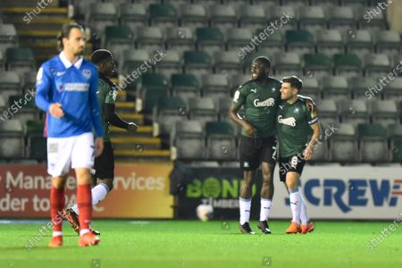 Goal 1-0 - Frank Nouble (7) of Plymouth Argyle celebrates the own goal scored by Sean Raggett (20) of Portsmouth during the EFL Sky Bet League 1 match between Plymouth Argyle and Portsmouth at Home Park, Plymouth